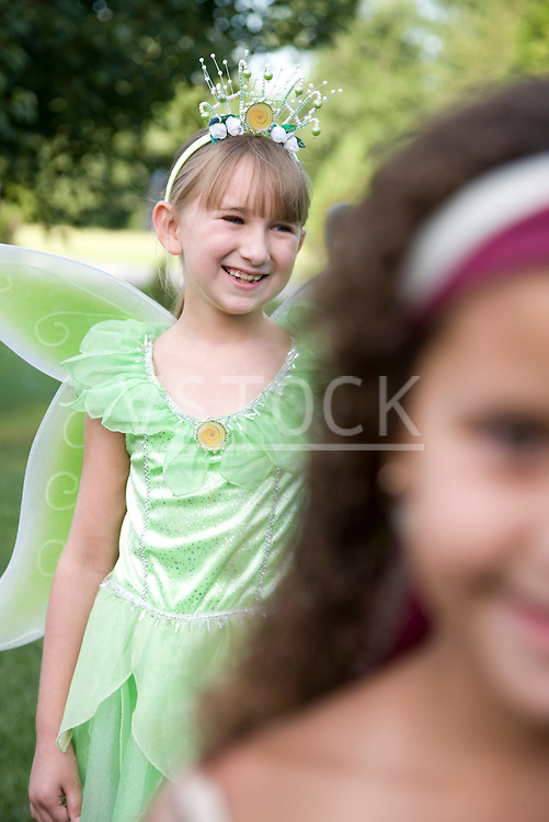 Two girls (8-9) in Halloween costumes