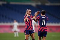 SAITAMA, JAPAN - JULY 24: Alex Morgan #13 and Christen Press #11 of the United States celebrate during a game between New Zealand and USWNT at Saitama Stadium on July 24, 2021 in Saitama, Japan.