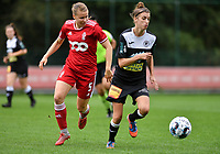 Aster Janssens (5) of Standard and Justine Blave (22) of Eendracht Aalst in action during a female soccer game between Standard Femina de Liege and Eendracht Aalst dames on the fourth matchday in the 2021 - 2022 season of the Belgian Scooore Womens Super League , Saturday 11 th of September 2021  in Angleur , Belgium . PHOTO SPORTPIX   BERNARD GILLET