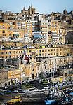 Late afternoon light illuminates Valletta in Malta.