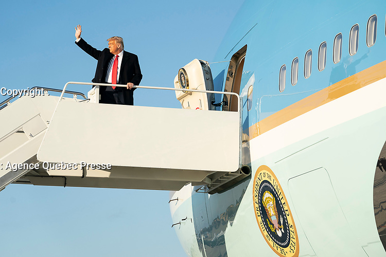 President Trump Travels to North Carolina<br /> <br /> President Donald J. Trump  waves as he boards Air Force One at Joint Base Andrews, Md. Wednesday, Oct. 21, 2020, en route to Charlotte Douglas International Airport in Charlotte, N.C. (Official White House Photo by Joyce N. Boghosian)