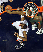 CHARLOTTESVILLE, VA- JANUARY 7: Reggie Johnson #42 of the Miami Hurricanes reaches for the rebound next to Darion Atkins #32 of the Virginia Cavaliers during the game on January 7, 2012 at the John Paul Jones Arena in Charlottesville, Virginia. Virginia defeated Miami 52-51. (Photo by Andrew Shurtleff/Getty Images) *** Local Caption *** Darion Atkins;Reggie Johnson