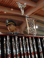 A security guard is reflected in the spoiler of a Rolls Royce Phantom at the Guangzhou luxury goods fair in China. .16 Dec 2006
