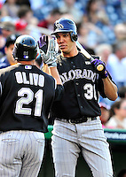 22 April 2010: Colorado Rockies' starting pitcher Ubaldo Jimenez gives Miguel Olivo a greeting at home plate after Olivo hits a solo home run during a game against the Washington Nationals at Nationals Park in Washington, DC. The Rockies shut out the Nationals 2-0 gaining a 2-2 series split. Mandatory Credit: Ed Wolfstein Photo