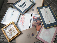 BNPS.co.uk (01202 558833)<br /> Pic: PhilYeomans/BNPS<br /> <br /> Royal dress designs are preserved in picture frames.<br /> <br /> A remarkable 'timewarp' archive amassed by a dressmaker to the Queen has sold for over £100,000.<br /> <br /> The late Ian Thomas meticulously kept his fashion designs, letters, cards and photographs relating to the Queen at his home that was more like a museum. <br /> <br /> He helped design the Queen's coronation gown in 1953 as well as the powder blue outfit she wore for Charles and Diana's wedding in 1981.<br /> <br /> The lifelong bachelor passed away in 1993 and left his home and its contents to a florist he had been good friends with for 25 years.<br /> <br /> After she died in 2015 the property was inherited by a relative who also knew Mr Thomas well.<br /> <br /> She has now sold the contents at auction.