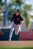 Detroit Tigers left fielder Brandon Dixon (12) runs the bases during a Grapefruit League Spring Training game against the Baltimore Orioles on March 3, 2019 at Ed Smith Stadium in Sarasota, Florida.  Baltimore defeated Detroit 7-5.  (Mike Janes/Four Seam Images)