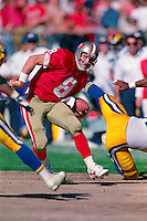 SAN FRANCISCO, CA - Quarterback Steve Young of the San Francisco 49ers runs with the football during a game against the Los Angeles Rams at Candlestick Park in San Francisco, California in 1992. Photo by Brad Mangin
