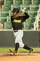 Dilson Herrera (31) of the West Virginia Power follows through on his swing against the Kannapolis Intimidators at CMC-Northeast Stadium on July 9, 2013 in Kannapolis, North Carolina.  The Power defeated the Intimidators 3-1.   (Brian Westerholt/Four Seam Images)