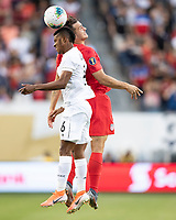 KANSAS CITY, KS - JUNE 26: Kevin Galvan #6 and Jordan Morris #11 vie for a header during a game between United States and Panama at Children's Mercy Park on June 26, 2019 in Kansas City, Kansas.