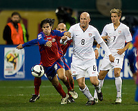 Conor Casey battles for a ball during a 2-2 tie with Costa Rica to put the USA in first place of CONCACAF 2010 World Cup qualifying, at RFK Stadium, in Washington DC, Wednesday, October 14, 2009.