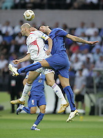 Italian defender (23) Marco Materazzi goes up for a header against French midfielder (10) Zinedine Zidane.  Italy defeated France on penalty kicks after leaving the score tied, 1-1, in regulation time in the FIFA World Cup final match at Olympic Stadium in Berlin, Germany, July 9, 2006.
