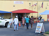 LAUDERHILL, FL - OCTOBER 14: Voters seen  depositing their vote by mail ballot at the Broward County Supervisor of Elections office during the 2020 Presidential Election on October 14, 2020 in Lauderhill, Florida. <br /> CAP/MPI04<br /> ©MPI04/Capital Pictures