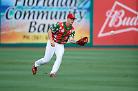 "Palm Beach Cardinals left fielder Shane Billings (22) fields a base hit during a game against the Charlotte Stone Crabs on July 22, 2017 at Roger Dean Stadium in Palm Beach, Florida.  The Cardinals wore special ""Ugly Sweater"" jerseys for Christmas in July.  Charlotte defeated Palm Beach 5-2.  (Mike Janes/Four Seam Images)"