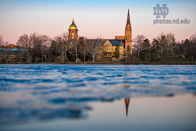 March 6, 2021; The sun sets over a thawing St. Mary's Lake. (Photo by Matt Cashore/University of Notre Dame)