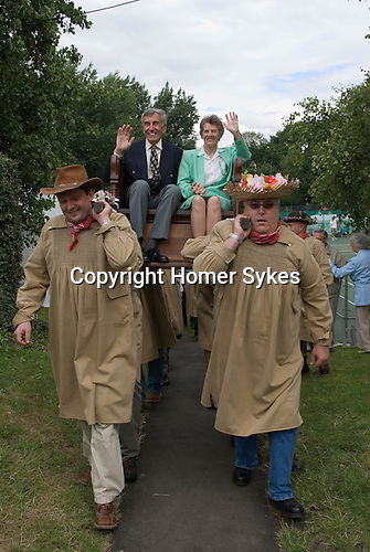 Dunmow Flitch Trial. Great Dunmow, Essex.  UK 2008.  Winning married couple chaired from the court room marquee to the town square.