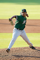 Augusta GreenJackets relief pitcher Carlos Diaz (18) in action against the Kannapolis Intimidators at CMC-NorthEast Stadium on August 3, 2014 in Kannapolis, North Carolina.  The Intimidators defeated the GreenJackets 10-5. (Brian Westerholt/Four Seam Images)