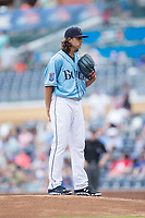 Durham Bulls starting pitcher Brent Honeywell (21) looks to his catcher for the sign against the Buffalo Bisons at Durham Bulls Athletic Park on April 30, 2017 in Durham, North Carolina.  The Bisons defeated the Bulls 6-1.  (Brian Westerholt/Four Seam Images)
