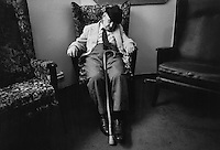 An elderly man sleeps in his chair in Camden Town old people's home, London.