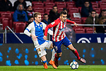 Angel Correa (R) of Atletico de Madrid competes for the ball with Raul Garcia Carnero, Raul C, of CD Leganes during the La Liga 2017-18 match between Atletico de Madrid and CD Leganes at Wanda Metropolitano on February 28 2018 in Madrid, Spain. Photo by Diego Souto / Power Sport Images