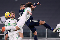 Cristiano Ronaldo of Juventus FC and Gian Marco Ferrari of US Sassuolo compete for the ball during the Serie A football match between Juventus FC and US Sassuolo Calcio at Allianz stadium in Torino (Italy), January 10th, 2021. Photo Federico Tardito / Insidefoto