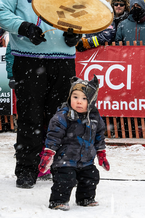 Young Kingikmiut Dancer from Whales, Alaska start off the festivities at 4th Avenue and D street in downtown Anchorage, Alaska on Saturday March 7th during the 2020 Iditarod race. Photo copyright by Cathy Hart Photography.com
