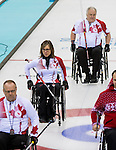 Sochi, RUSSIA - Mar 13 2014 - Sonja Gaudet, Ina Forrest and Jim Armstrong as Canada takes on Slovakia in round robin play at the 2014 Paralympic Winter Games in Sochi, Russia.  (Photo: Matthew Murnaghan/Canadian Paralympic Committee)