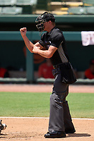 Umpire Chase Eubanks calls a strike during a game between the FCL Pirates Gold and FCL Orioles Orange on August 9, 2021 at Ed Smith Stadium in Sarasota, Florida.  (Mike Janes/Four Seam Images)