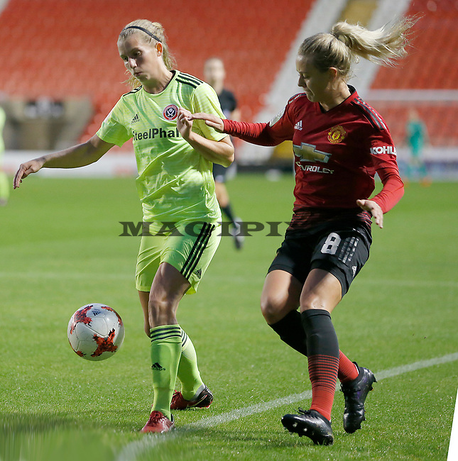 Mollie Green of Manchester United Women and Lisa Ryan of Sheffield Utd Women