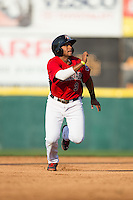 Josh Morgan (3) of the Hickory Crawdads takes off for third base during the game against the Greensboro Grasshoppers at L.P. Frans Stadium on May 6, 2015 in Hickory, North Carolina.  The Crawdads defeated the Grasshoppers 1-0.  (Brian Westerholt/Four Seam Images)