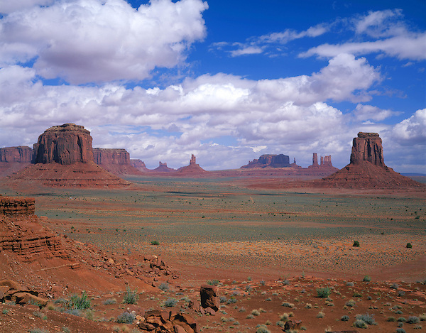 The Mittens buttes from Artist Point in Monument Valley, Arizona, USA. . John offers private photo tours in Monument Valley and throughout Arizona, Utah and Colorado. Year-round.