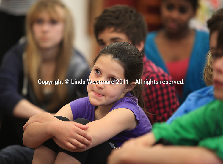 "Cast members watching others.  The Yvonne Arnaud Youth Theatre rehearsing ""The Lion, the Witch and the Wardrobe"", Guildford, Surrey."