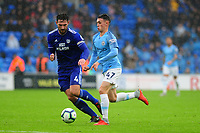 Sean Morrison of Cardiff City vies for possession with Phil Foden of Manchester City during the Premier League match between Cardiff City and Manchester City at Cardiff City Stadium on  in Cardiff, Wales, UK. Saturday 22 September 2018