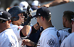 The Reno Aces greet Ildemaro Vargas in the dugout after he scored against the Tacoma Rainiers at Greater Nevada Field in Reno, Nev., on Sunday, Aug. 28, 2016. <br />Photo by Cathleen Allison