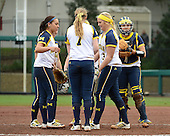 Michigan Wolverines team huddle including shortstop Sierra Romero (32), utility player Kelsey Susalla (7), pitcher Megan Betsa (3), and catcher Lauren Sweet (25) during the season opener against the Florida Gators on February 8, 2014 at the USF Softball Stadium in Tampa, Florida.  Florida defeated Michigan 9-4 in extra innings.  (Copyright Mike Janes Photography)