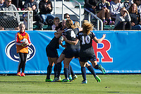 Cary, North Carolina - Sunday December 6, 2015: The Penn State Nittany Lions celebrate after Raquel Rodriguez (left) scored what would turn out to be the only goal of the game against the Duke Blue Devils at the 2015 NCAA Women's College Cup at WakeMed Soccer Park.  The Nittany Lions defeated the Blue Devils 1-0.