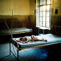 A young girl suffering from malaria in a small health clinic in the state of Orissa, which is the Indian state most affected by malaria, with 25 to 30 percent of all malaria cases diagnosed in the country.