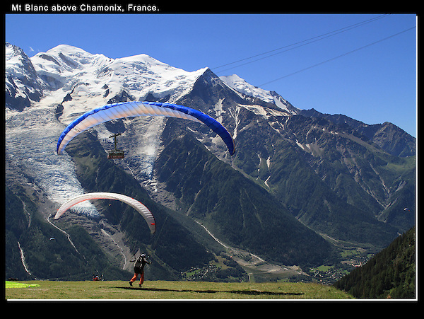 France, Chamonix.  <br /> I made a nice composition and waited for the paragliders and cable car to pass through the frame. This ensures I'll include both Mt Blanc and Chamonix below. Year round tours in Colorado.