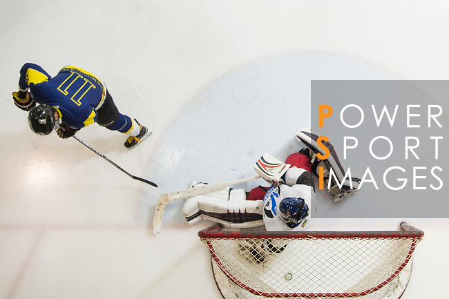 Gaggia Empire Goalkeeper Rex Kong (right) defends his goal against Verity Skater #11 Ryan Wong (left) during the match Gaggia Empire vs Verity, a match part of the Principal Standard League on 07 March 2017 in Mega Ice, Hong Kong, China. Photo by Marcio Rodrigo Machado / Power Sport Images