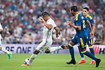 Real Madrid's player Carlos Henrique Casemiro and Celta de Vigo's player Gustavo Daniel Cabral during a match of La Liga Santander at Santiago Bernabeu Stadium in Madrid. August 27, Spain. 2016. (ALTERPHOTOS/BorjaB.Hojas)