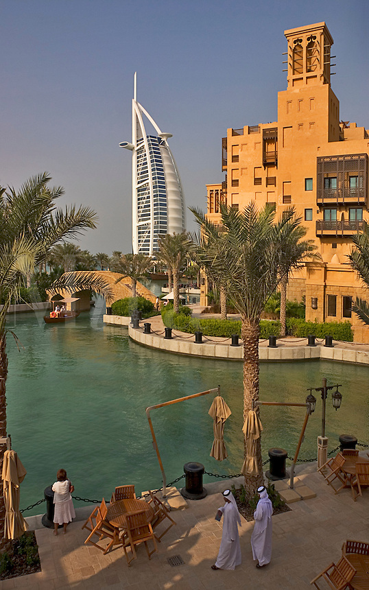 Dubai, United Arab Emirates. Madinat Jumeirah. Burj al Arab Hotel and Mina A'Salam Hotel seen from the Souk/bazaar. Water taxi, abra..