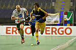 Berlin, Germany, January 31: Tobias Hauke #13 of Harvestehuder THC runs with the ball during the 1. Bundesliga Herren Hallensaison 2014/15 semi-final hockey match between Harvestehuder HTC(black/yellow) and HTC Uhlenhorst Muehlheim (white/green) on January 31, 2015 at the Final Four tournament at Max-Schmeling-Halle in Berlin, Germany. Final score 6-3 (2-2). (Photo by Dirk Markgraf / www.265-images.com) *** Local caption *** Tobias Hauke #13 of Harvestehuder THC, Thilo Stralkowski #11 of HTC Uhlenhorst Muehlheim