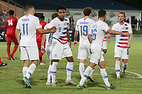 GEORGETOWN, GRAND CAYMAN, CAYMAN ISLANDS - NOVEMBER 19: Jordan Morris #11, Weston McKennie #8 and Josh Sargent #19 of the United States celebrate a Josh Sargent goal during a game between Cuba and USMNT at  Truman Bodden Sports Complex on November 19, 2019 in Georgetown, Grand Cayman.