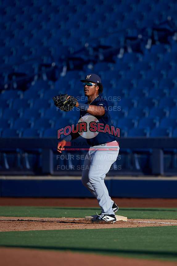 AZL Brewers Blue first baseman Caleb Marquez (21) prepares to catch a throw during an Arizona League game against the AZL Brewers Gold on July 13, 2019 at American Family Fields of Phoenix in Phoenix, Arizona. The AZL Brewers Blue defeated the AZL Brewers Gold 6-0. (Zachary Lucy/Four Seam Images)