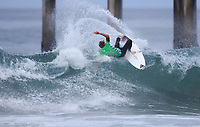 Huntington Beach, CA - Sunday July 30, 2017: Colt Ward during a Qualifying Series (QS) trials round heat in the 2017 Vans US Open of Surfing on the South side of the Huntington Beach pier.