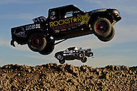 Dec. 18, 2009; Lake Elsinore, CA, USA; LOORRS unlimited light driver (82) Chris Brandt takes a jump as (46) Todd Cuffaro jumps in the foreground during qualifying for the Lucas Oil Challenge Cup at the Lake Elsinore Motorsports Complex. Mandatory Credit: Mark J. Rebilas-US PRESSWIRE