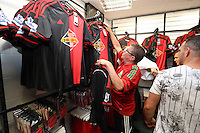 Pictured: A man goes through the new away kit shirts. Saturday 21 June 2014<br /> Re: Launch of the new home and away kit for Swansea City Football Club at the Liberty Stadium, south Wales.