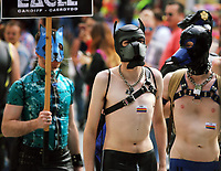 Men in leather outfits in this year's Pride Parade in the centre of Cardiff, Wales, UK. Sayurday 26 August 2017