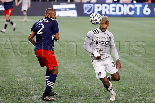 20th November 2020; Foxborough, MA, USA;  Montreal Impact forward Romell Quioto beats New England Revolution defender Andrew Farrell along the wing during the MLS Cup Play-In game between the New England Revolution and the Montreal Impact