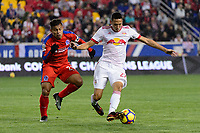 Harrison, NJ - Thursday March 01, 2018: German Mejía, Sean Davis. The New York Red Bulls defeated C.D. Olimpia 2-0 (3-1 on aggregate) during a 2018 CONCACAF Champions League Round of 16 match at Red Bull Arena.