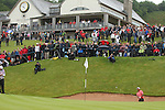 Tongchai Jaidee splashes out of the greenside bunker on the 18th to set up victory in the ISPS Handa Wales Open 2012..03.06.12.©Steve Pope